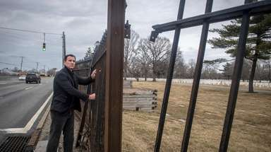 Rep. Thomas Suozzi looks at the disrepair of