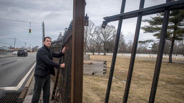 Rep. Thomas Suozzi looks at the disrepair of