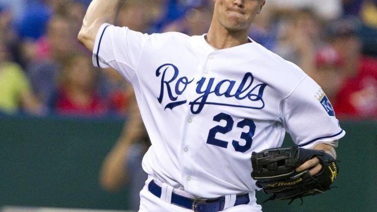 Kansas City Royals starting pitcher Zack Greinke fields