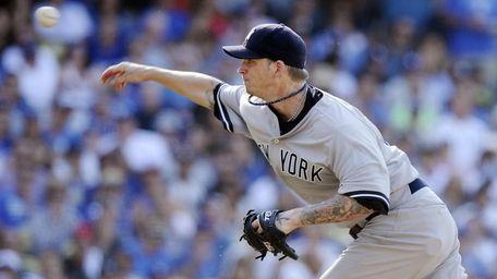 New York Yankees starting pitcher A.J. Burnett throws