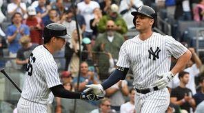 Yankees catcher Kyle Higashioka greets Greg Bird after