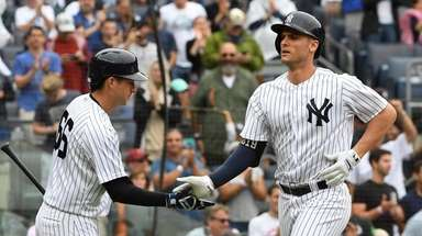 Yankees catcher Kyle Higashioka greets Greg Bird after