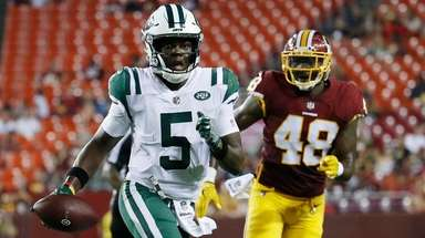 Quarterback Teddy Bridgewater of the Jets scrambles in