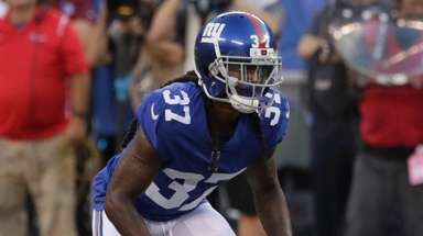 Giants defensive back B.W. Webb lines up against