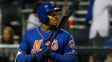 Dominic Smith of the Mets strikes out to
