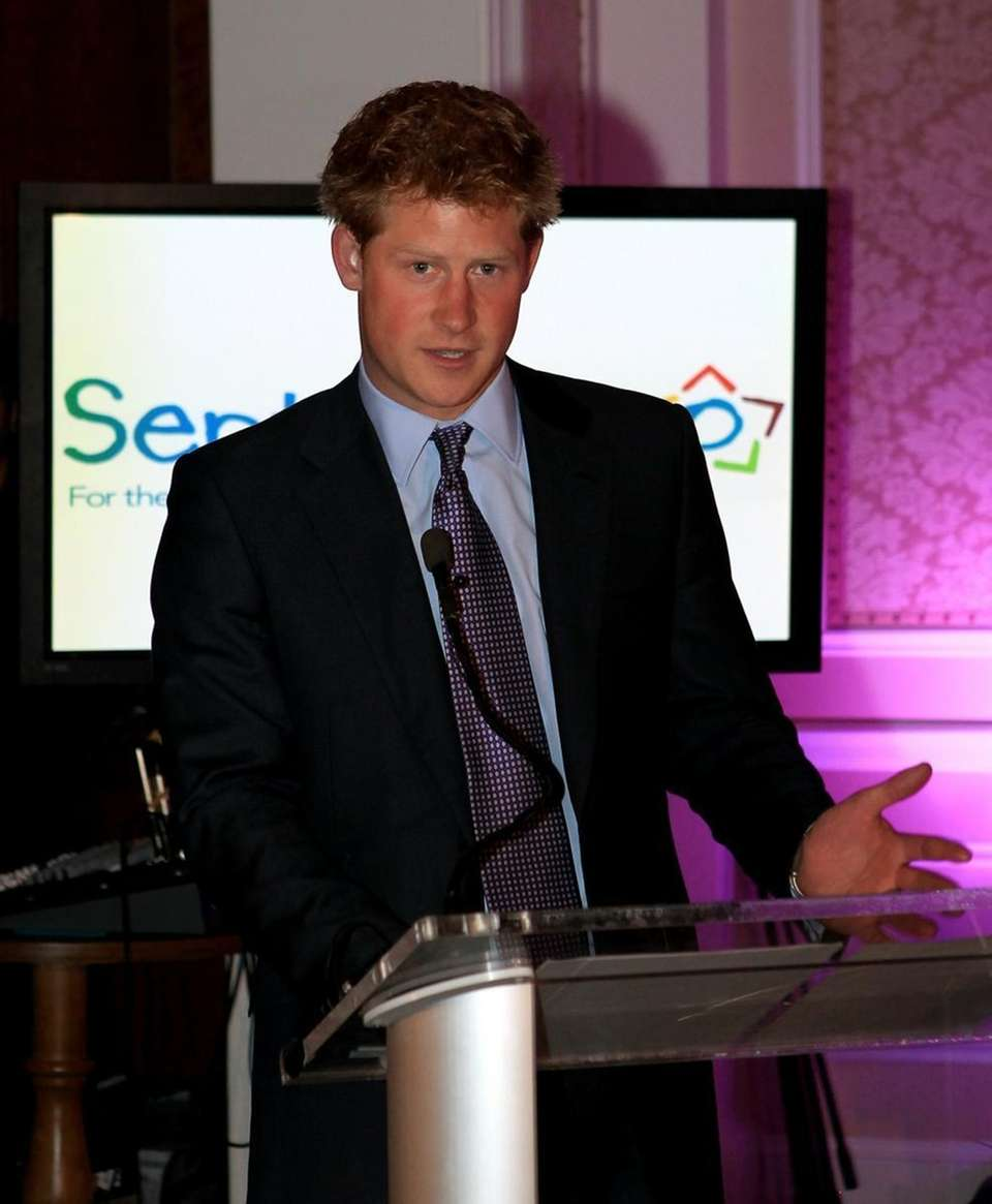 Prince Harry attends a reception for his charity,