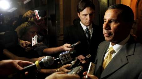 Gov. David Paterson talks to reporters about the