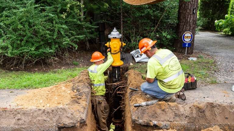 Contractors for the Suffolk County Water Authority install