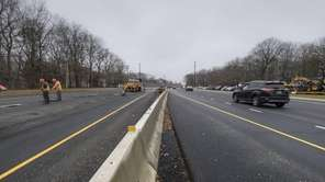 A construction crew works on Route 347 at