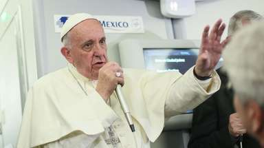 Pope Francis speaks to journalists aboard a flight