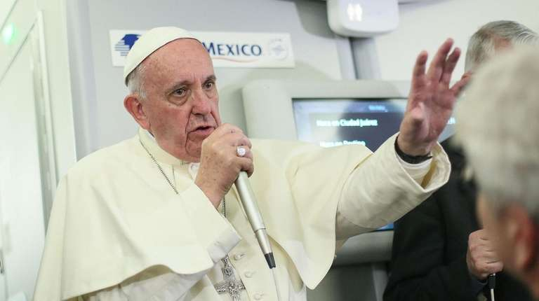 Pope Francis speaks to journalists aboard a flight