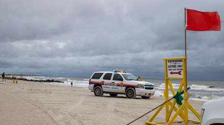 Nassau police patrol the beach where medical waste