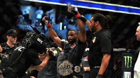 Tyron Woodley reacts to defeating Demian Maia in