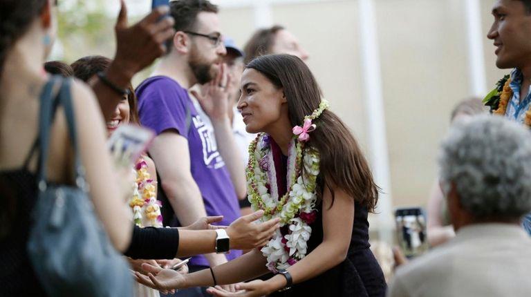 New York's Alexandria Ocasio-Cortez attends a campaign rally