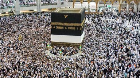 Muslim worshippers gather around the Kaaba, Islam's holiest
