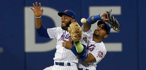 Amed Rosario and Dominic Smith of the Mets