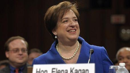Supreme Court nominee Elena Kagan smiles on as