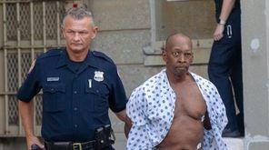 Anthony Robinson leaves Nassau police headquarters in Mineola