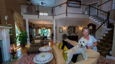 Cynthia Crockford and her dog Darla at her