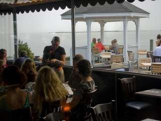 Diners on the outdoor patio of View, a