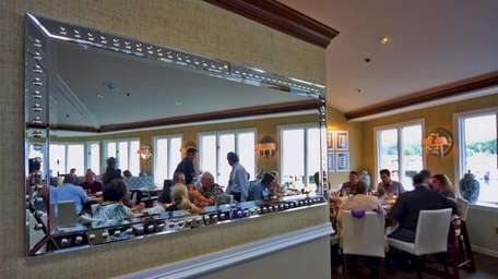Patrons dine in the interior dining room of
