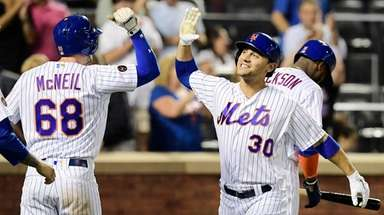 Michael Conforto of the Mets is congratulated by