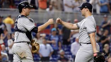 New York Yankees catcher Kyle Higashioka, left, bumps
