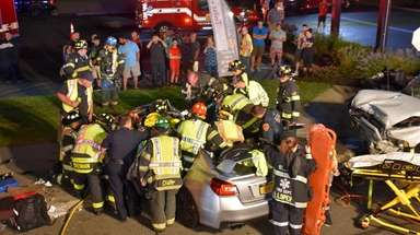 Rescuers respond to the scene where a silver