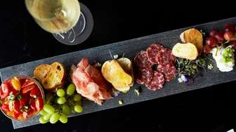 A salumi board with robiola cheese, Felino salami,