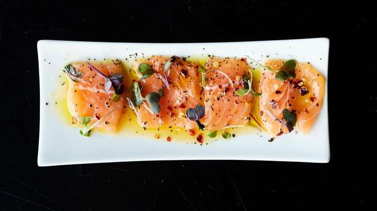A silky salmon crudo comes with toasted sesame