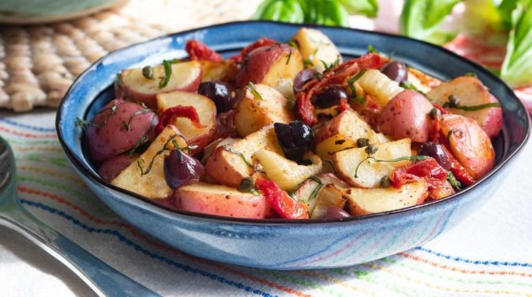 Potato salad made with fennel, olives, capers, sun