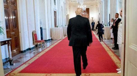 President Donald Trump departs a ceremony.