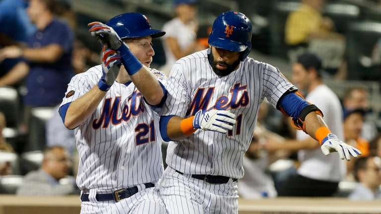 Jose Bautista of the Mets celebrates his fourth-inning