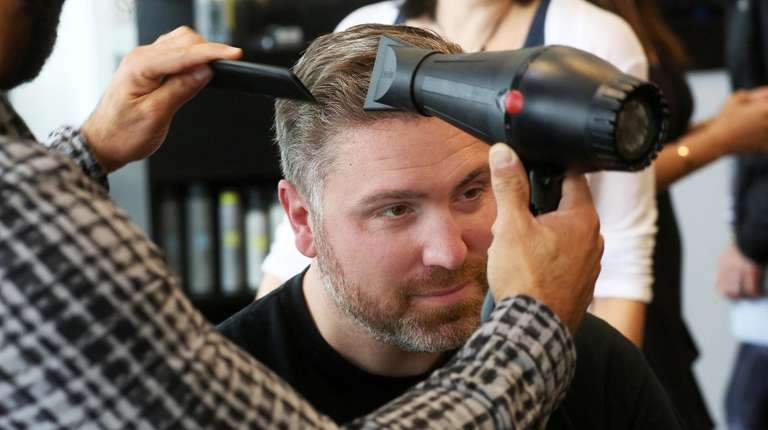 Keith Burns mid-makeover at Sorell Salon in Roslyn.