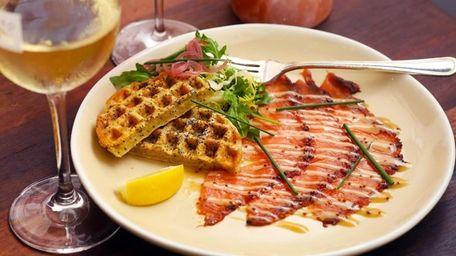 Pastrami-smoked salmon carpaccio arrives with a savory waffle