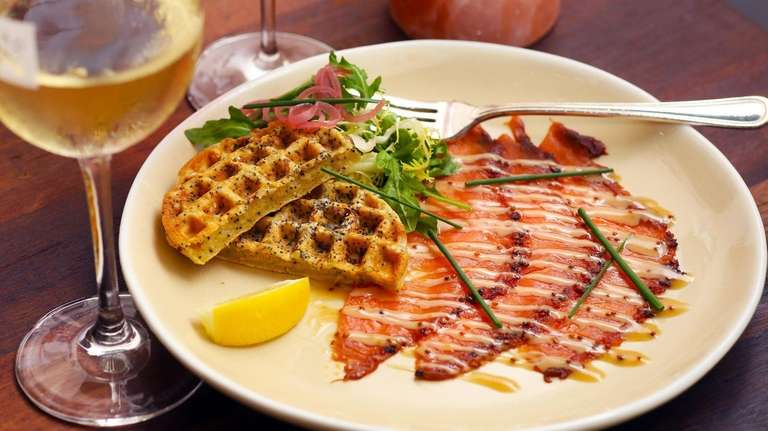 Pastrami-smoked salmon carpaccio arrives with a savory waffle