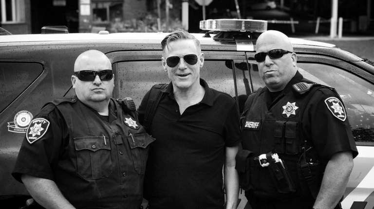 Singer Bryan Adams poses for a photo with