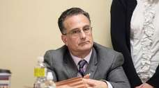 Leonard Genova, then-town attorney for Oyster Bay, at