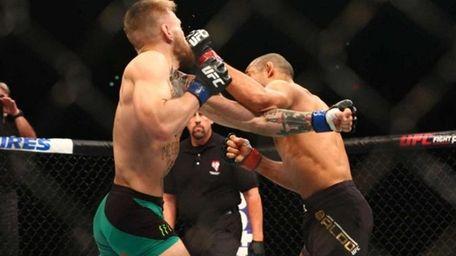 Conor McGregor, left, follows through on the knockout