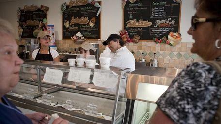 Leslie Rodriguez, left, and owner Daniel Levine work