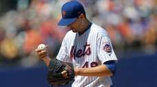 Jacob deGrom of the Mets stands on the