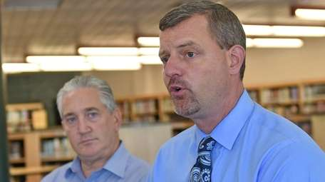 Kevin Coster, right, William Floyd school district superintendent,
