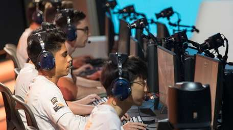 Philadelphia Fusion players compete during the Overwatch League