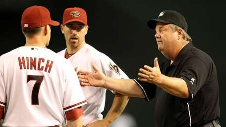 First base umpire Joe West reacts to manager