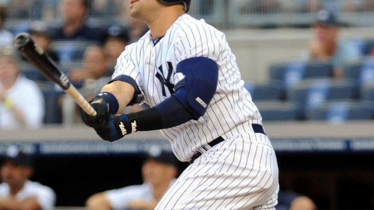New York Yankees' Nick Swisher (33) hits a