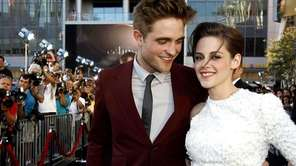 Robert Pattinson, left, and Kristen Stewart arrive at