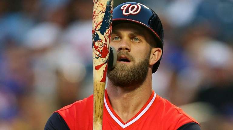 The Nationals' Bryce Harper looks at his hand-painted