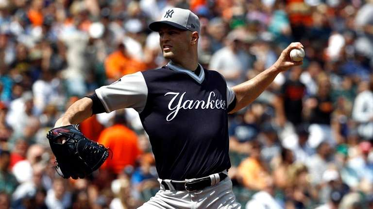 Yankees pitcher J.A. Happ delivers in the second