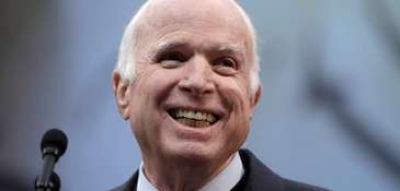 Sen. John McCain receives the Liberty Medal from