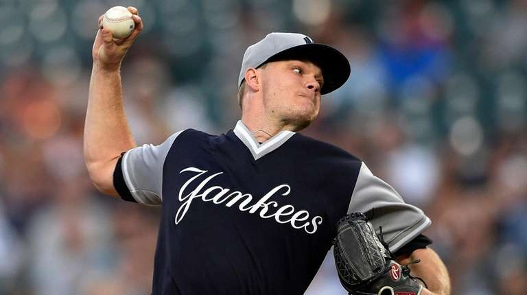 Yankees pitcher Sonny Gray delivers a pitch during